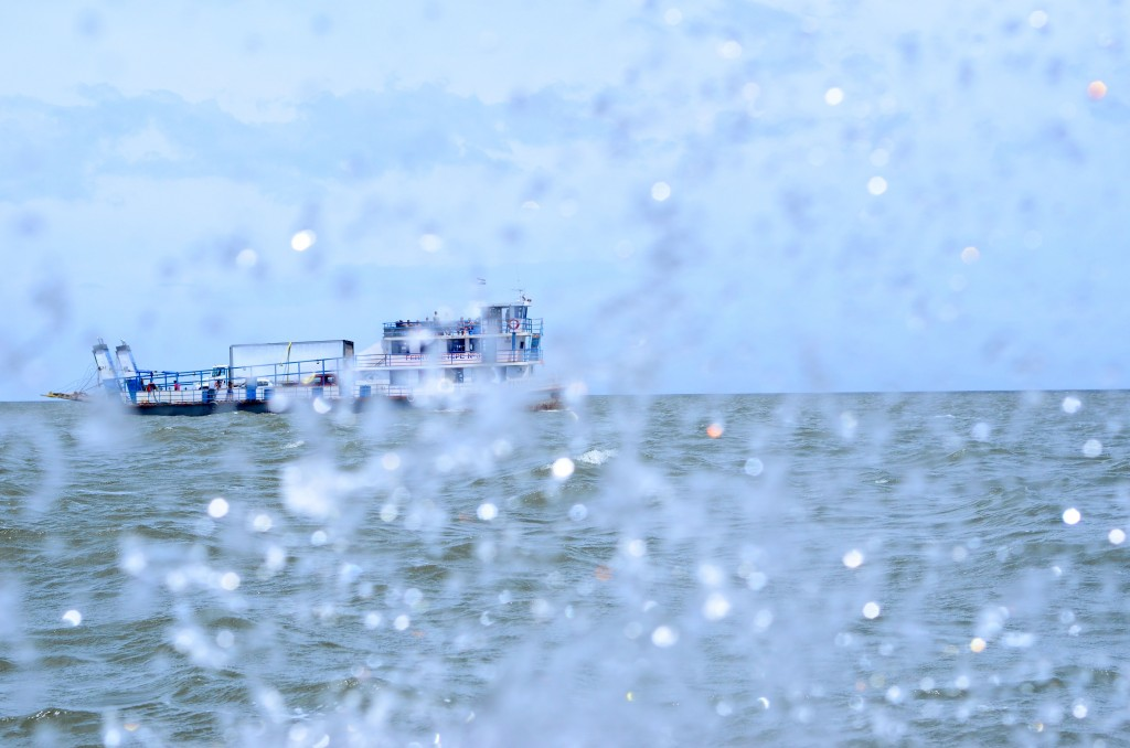 This was supposed to be a photo of the passing ferry, but our lancha was set on making sure I was drenched.